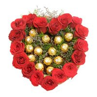 Rakhi and Chocolate Gifts to India with Heart Of 16 Pcs Ferrero Roacher N 18 Red Roses