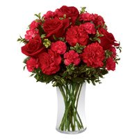 Rakhi Flowers to India with Red Roses Red Carnations in Vase for brother