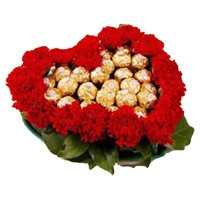 Rahki Gifts to India with 24 Red Carnation 24 Ferrero Rocher Heart Arrangement