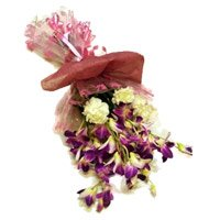 Rakhi with Orchid Flower Bouquet Delivery in India on Rakhi