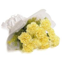 Send Online Rakhi and Yellow Carnation Bouquet to India