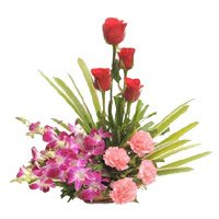 Send rchids, Roses, Carnation Basket 12 Flowers with Rakhi in India
