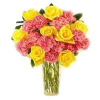 Rakhi Gifts Pink Carnation Yellow Rose in Vase 24 Flowers with Rakhi for brother