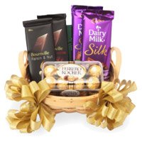 Send Rakhi and Silk, Bournville and Ferrero Rocher Basket of Chocolate Delivery in India