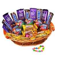 Online Rakhi Gift Delivery to India that includes Cadbury Snicker Chocolate Basket on Rakhi