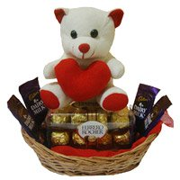 Deliver 4 Dairy Milk 16 Ferrero Rocher Chocolates with Rakhi to India and 6 Inch Teddy Basket