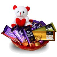 Online Delivery of Rakhi to India with Dairy Milk, Silk, Temptation Chocolates to India with 6 Inch Teddy Basket