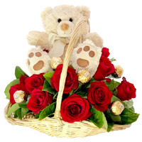 Send Rakhi Gifts in India with 12 Red Roses, 10 Ferrero Rocher and 9 Inch Teddy Basket With Rakhi