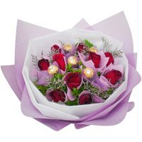 Deliver Rakhi to India with 12 Red Roses 5 Ferrero Rocher Bouquet