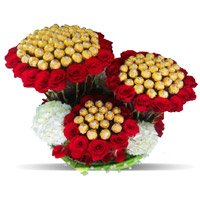 Send Online Rakhi with 96 Pcs Ferrero Rocher and 200 Red White Roses Bouquet