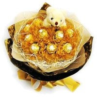 Deliver Rakhi Gifts to India consist of 16 Pcs Ferrero Rocher 6 Inch Teddy Bouquet on Rakhi