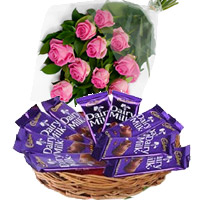 Place Order for Rakhi and Dairy Milk Basket 12 Chocolates With 12 Pink Roses in India