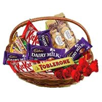 Deliver Rakhi with Basket of Assorted Chocolate to India and 10 Red Roses