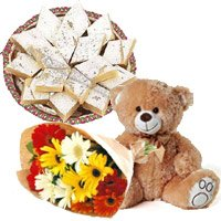 Send Flower Online to Goa. 12 Gerbera Bouquet, 1/2 Kg Kaju Burfi, 1 Teddy Bear on Rakhi