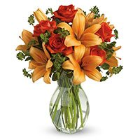Deliver Rakhi with Orange Lily Red Roses Flowers to India