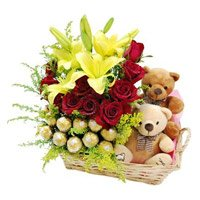 Rakhi Gifts Online to India 2 Lily 12 Roses 16 Ferrero Rocher Twin Small Teddy Basket