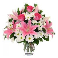 Deliver White Lily 6 Pink Rose 10 White Gerbera with Rakhi to India