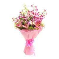 Send Rakhi with Pink Lily Purple Orchid Flowers in India Online