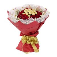 Best Rakhi and Ferrero Rocher encircled with 20 Red Roses