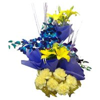 Send 4 Yellow Lily 4 Blue Orchids 6 Yellow Carnation Basket with Rakhi to India